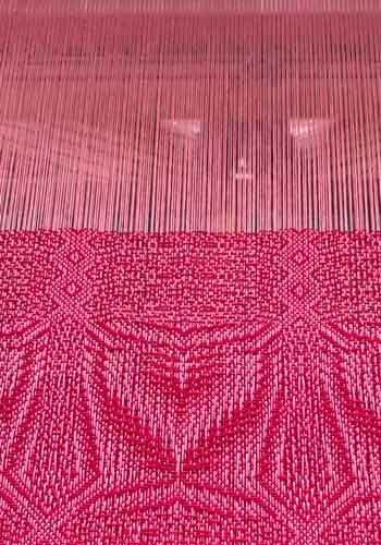Coral Challenge Towel on the Loom
